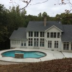 far shot of house with in-ground pool