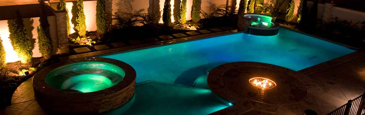 stunning in-ground pool at night
